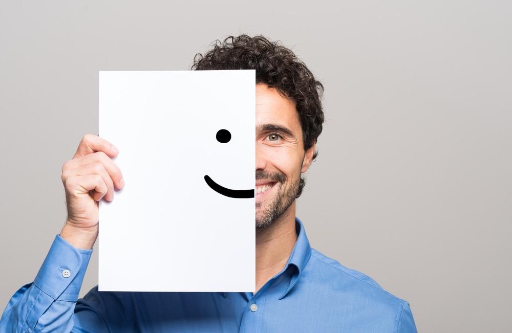 https://www.shutterstock.com/ja/image-photo/happy-man-covering-half-his-face-376687903